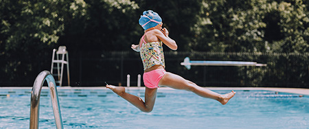 Girl diving into a pool.